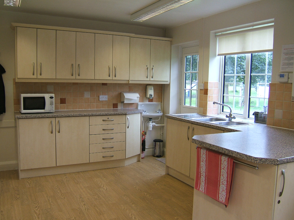 Hall kitchen worktops and door to play area