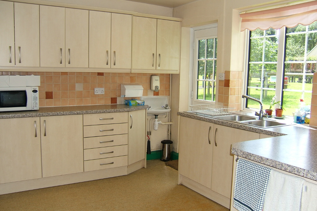 Kitchen with door to play area