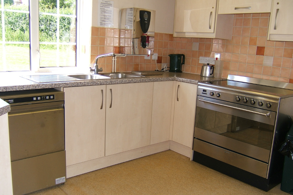 Kitchen with stainless steel range cooker and dishwasher